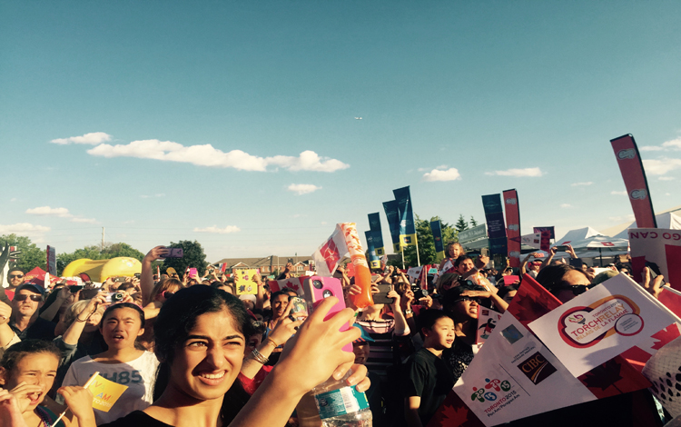 Crowds cheer Pan Am Games flame in Richmond Hill on Wednesday.