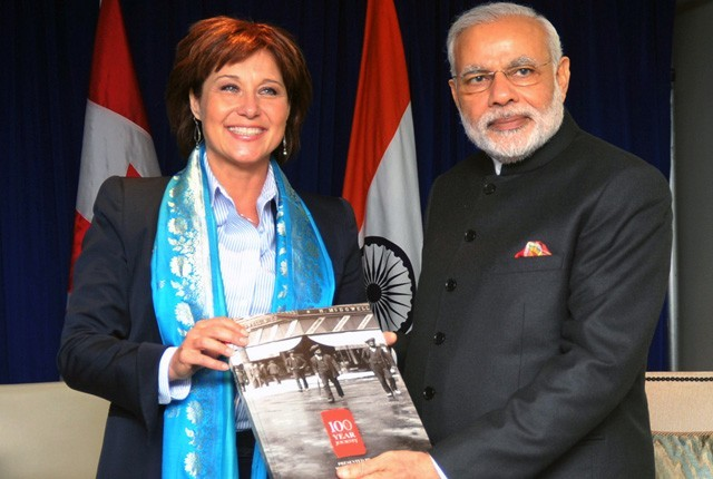 Premier of British Columbia, Mrs. Christy Clark, giving a copy of the book to Prime Minister, Shri Narendra Modi, in Vancouver on April 16, 2015.